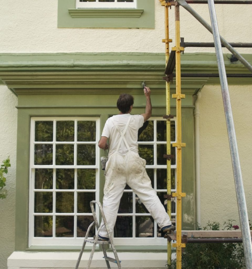 Painter and decorator working.