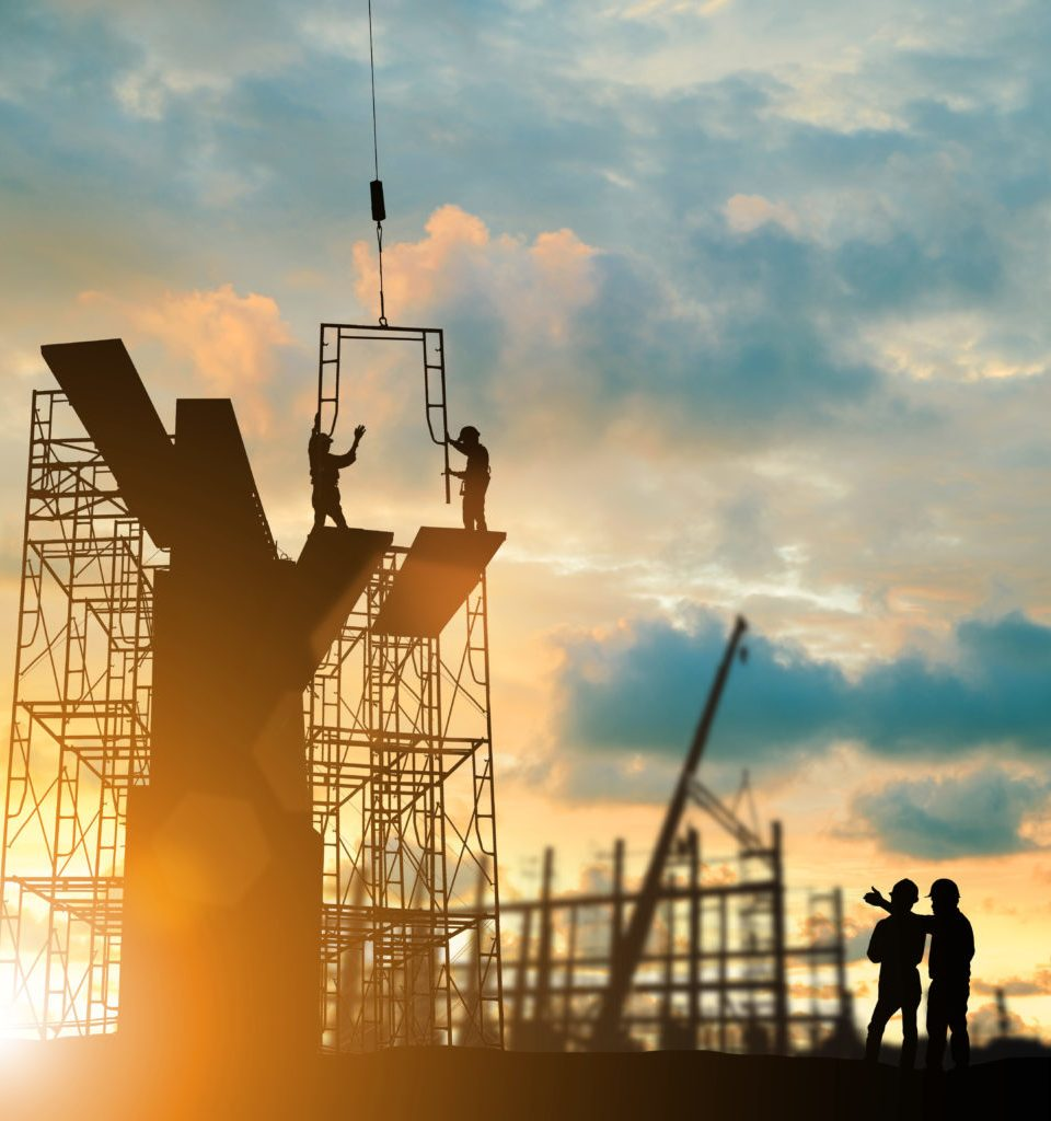 Silhouette engineer  look team construction safely to work load scaffolding over blurred background sunset pastel for industry background with Light fair